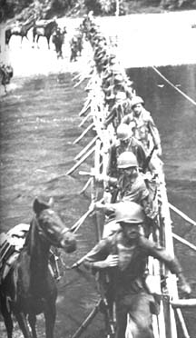 Merrill's Marauders crossing a  river